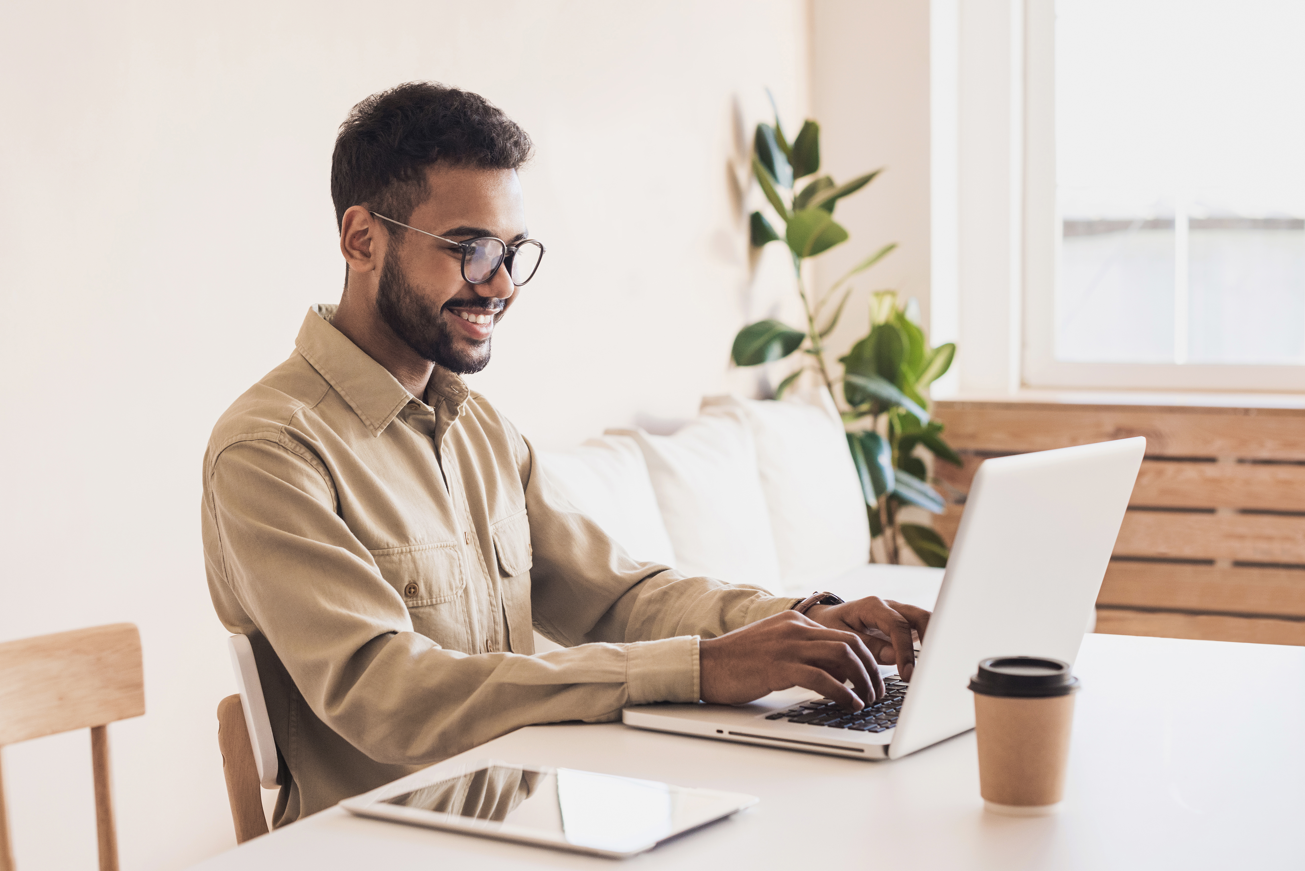 Business man typing on laptop computer