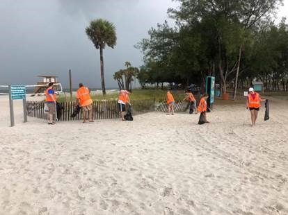 BRP Colleagues in Action clean up beachfront on cloudy day