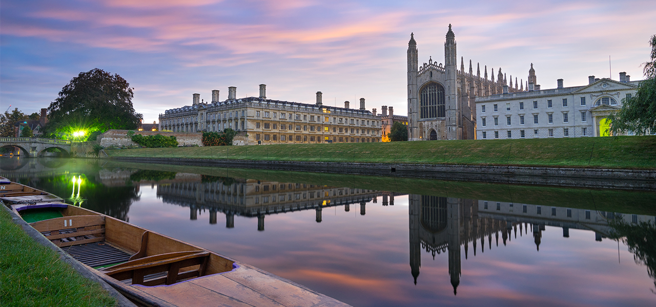 Clare & King's College with beautiful sky at sunrise and fog on cam river in Cambridge, UK