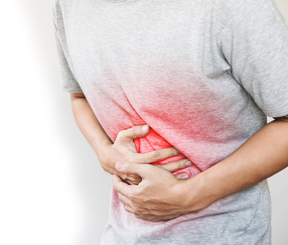 Person holding stomach in pain