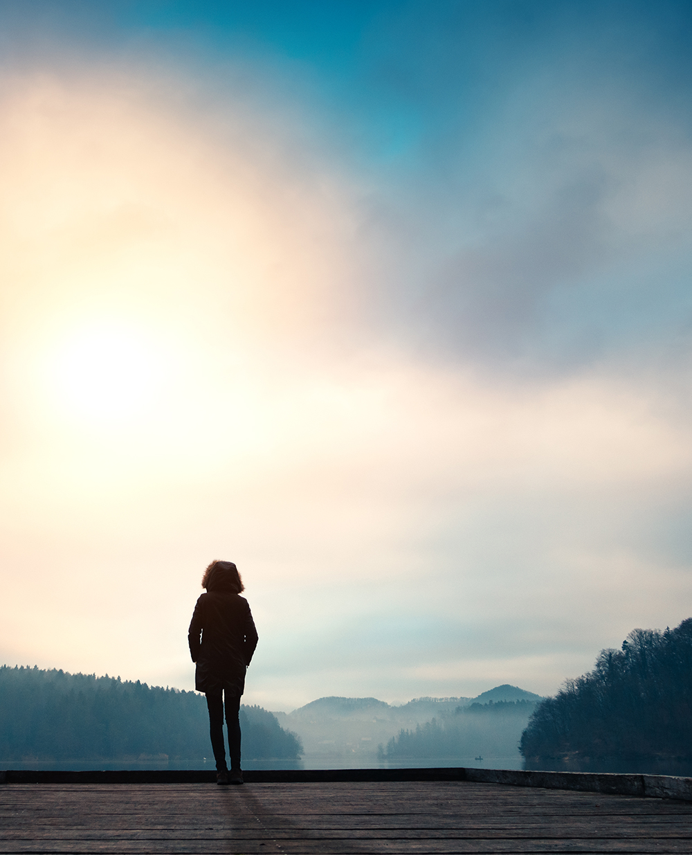 Woman looking peacefully into scenic background