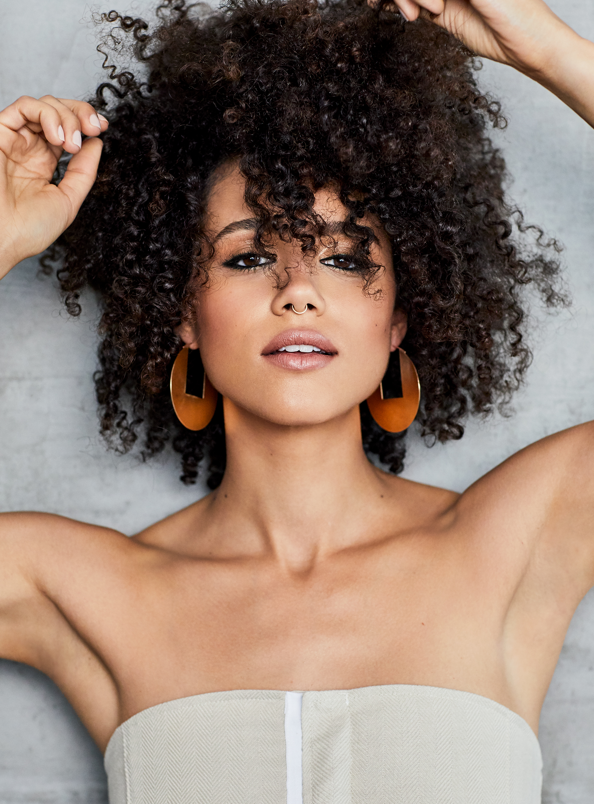 game of thrones star nathalie emmanuel on fame, fear, and her iconic