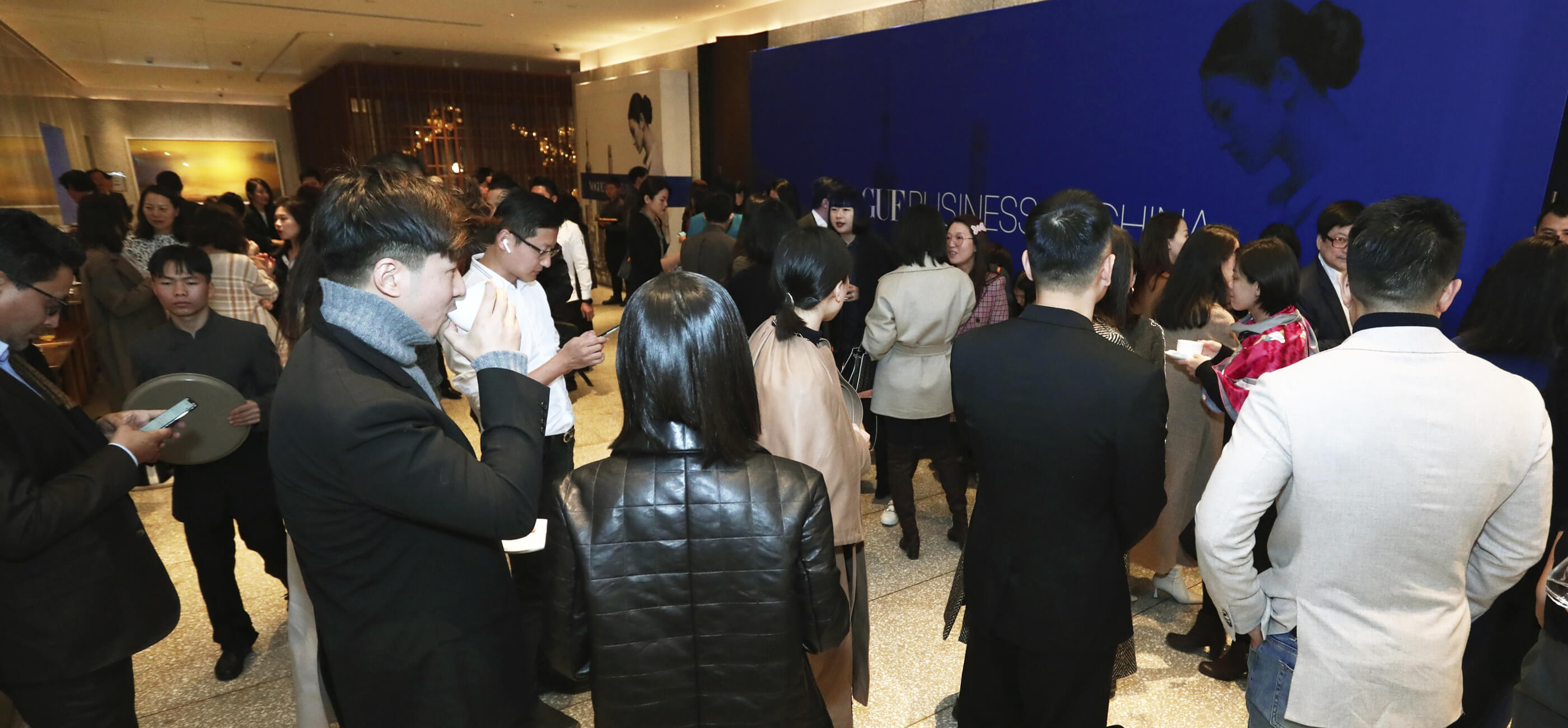 This image may contain: vogue business,  photograph, digital, vogue business in china, people, event, gathering, networking