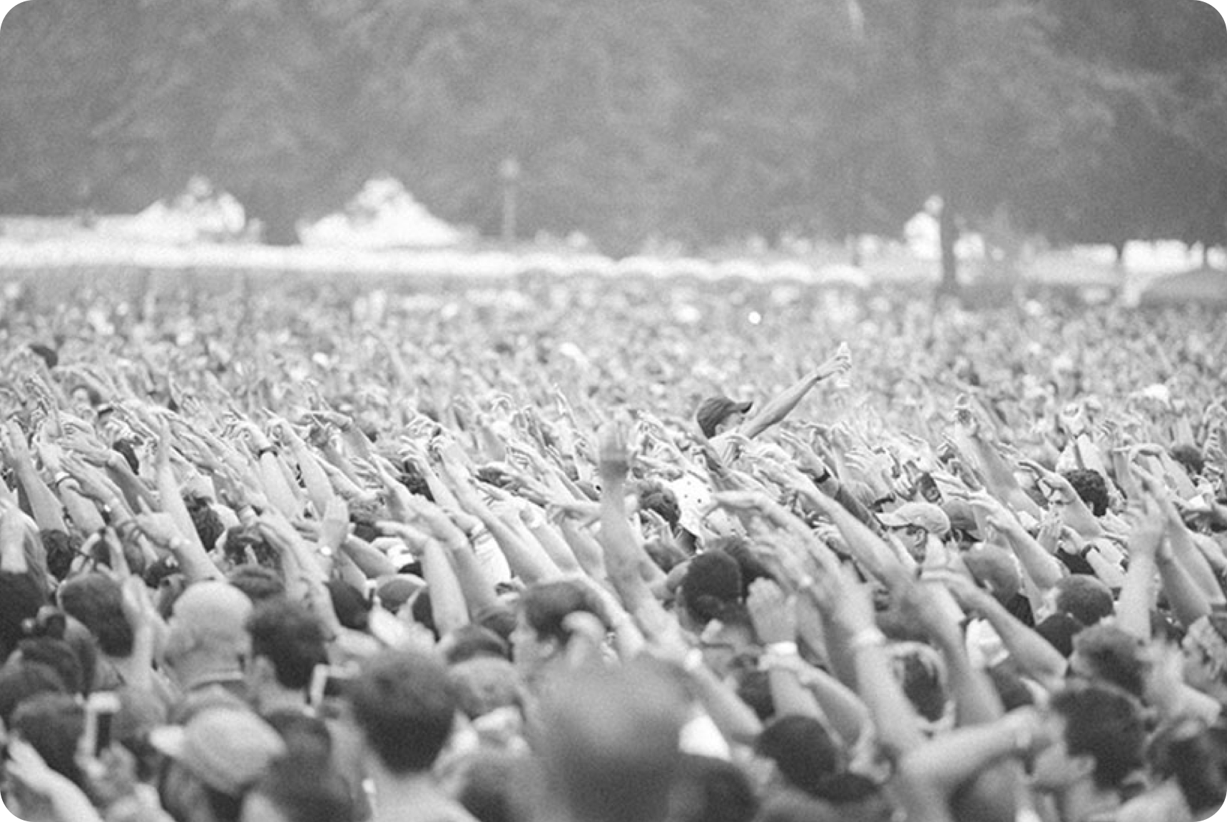 Large crowd with their hands in the air