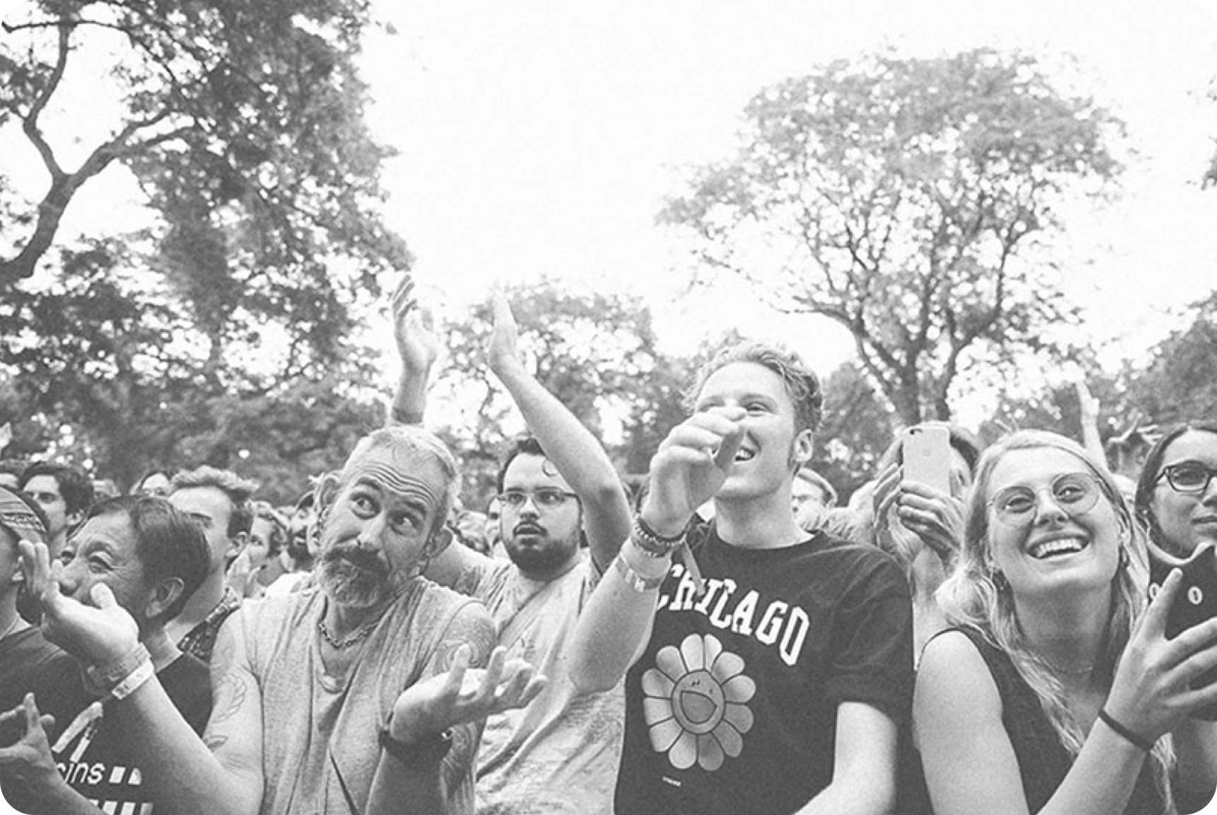 Group of people smiling and clapping their hands