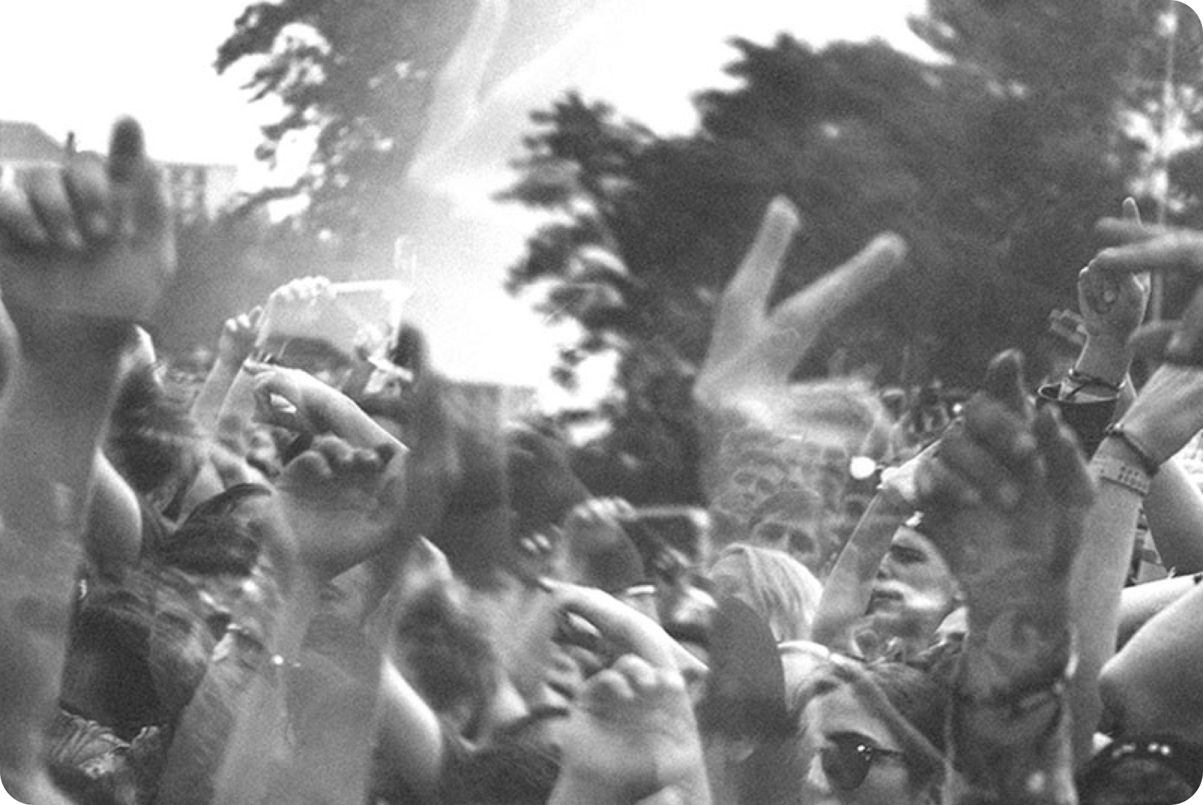 A blurred shot of arms extended in the air