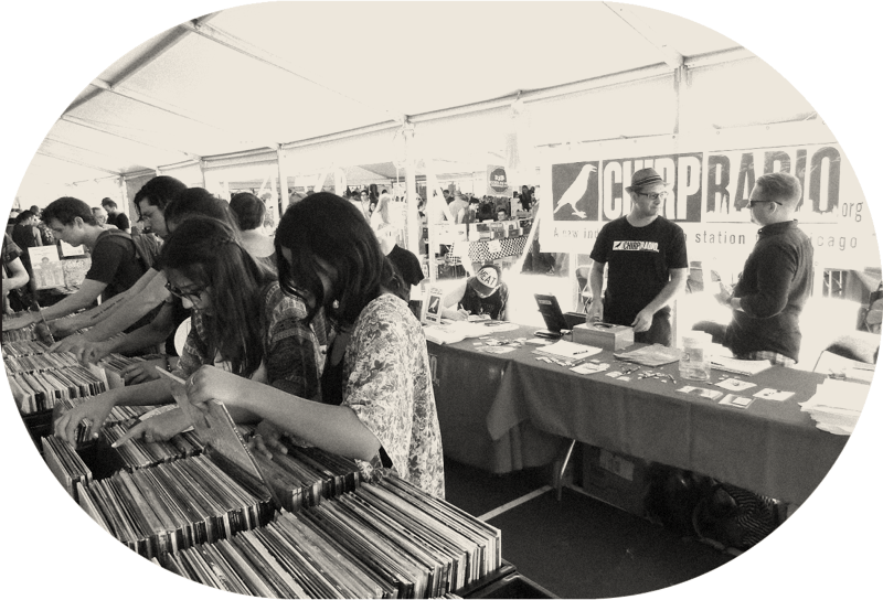People rummaging through crates of vinyl records