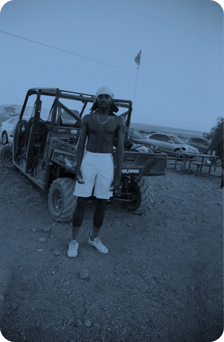 Artist Blood Orange standing in front of a truck