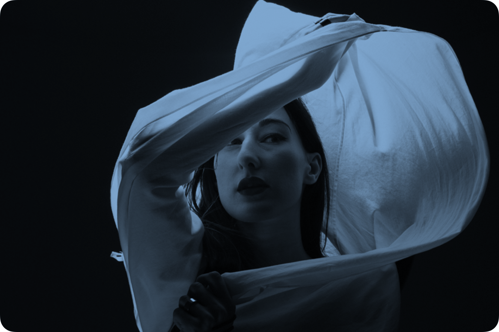 Portrait of artist Zola Jesus twirling fabric