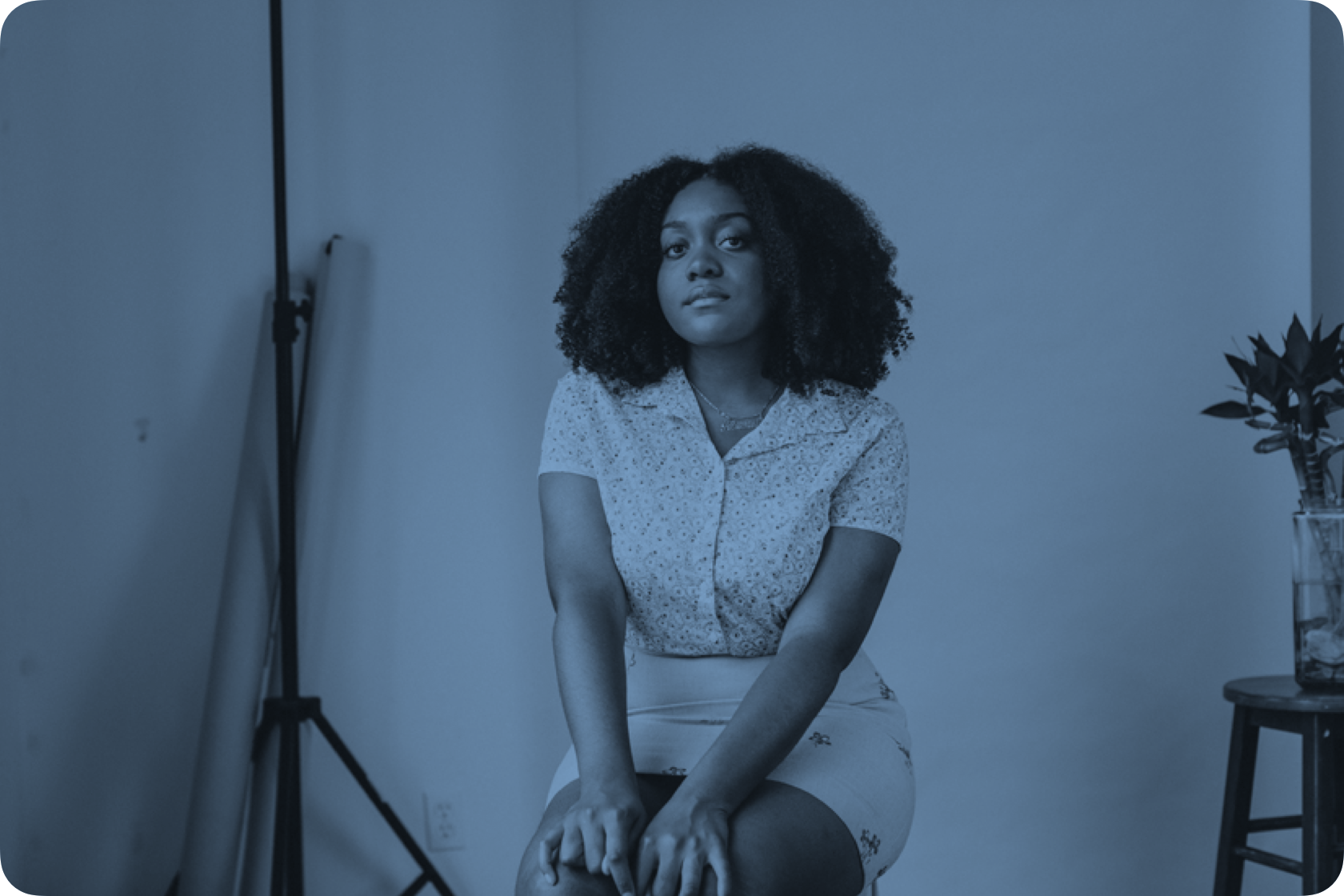 Portrait of NoName sitting in a chair