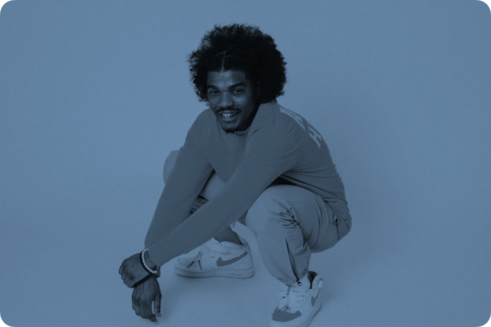 Portrait of Smino crouching