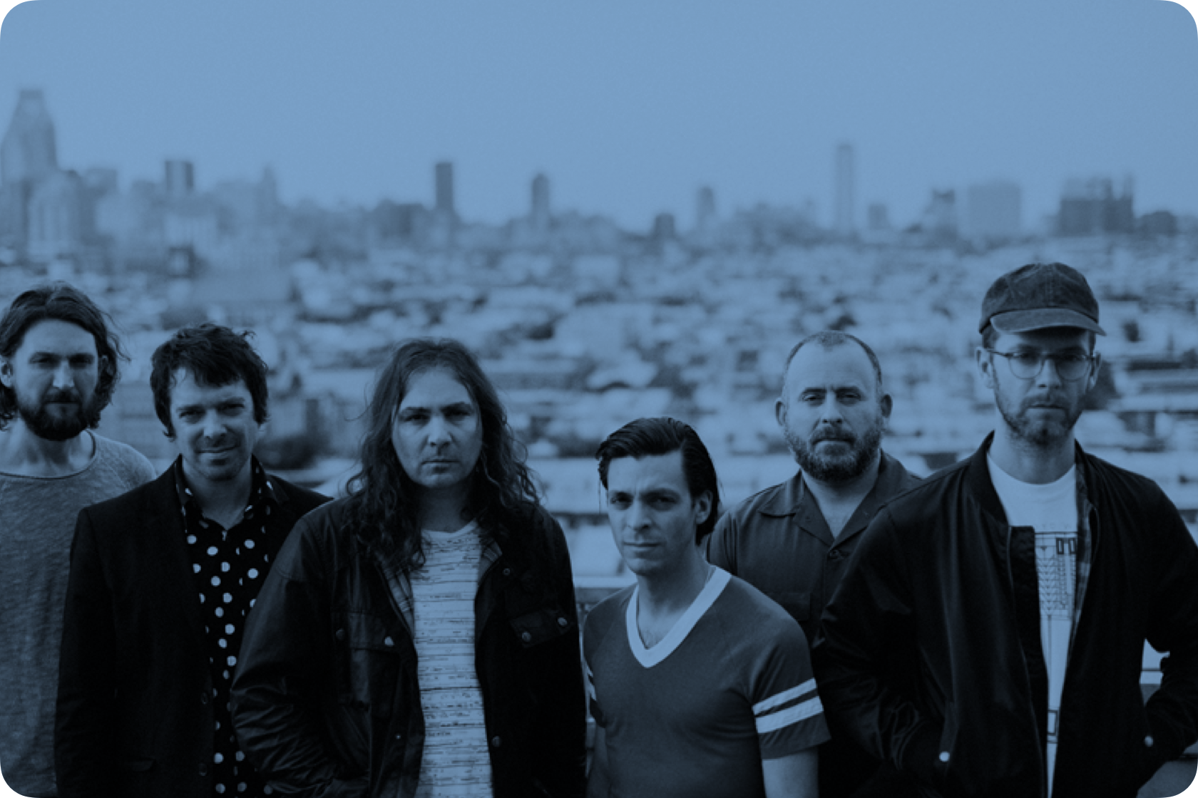 Members of the War on Drugs with a city in the background
