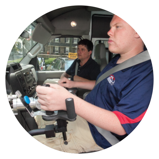 man using an assistive device to drive