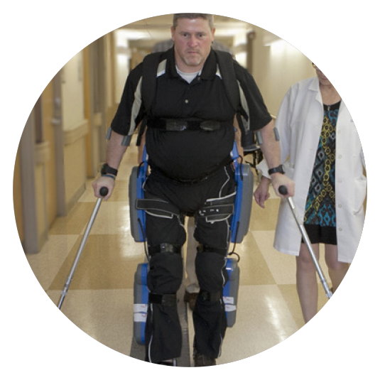 man using a robotic device to walk