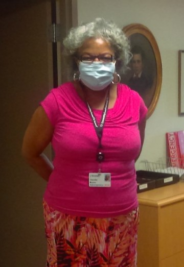 picture of an employee in a face mask