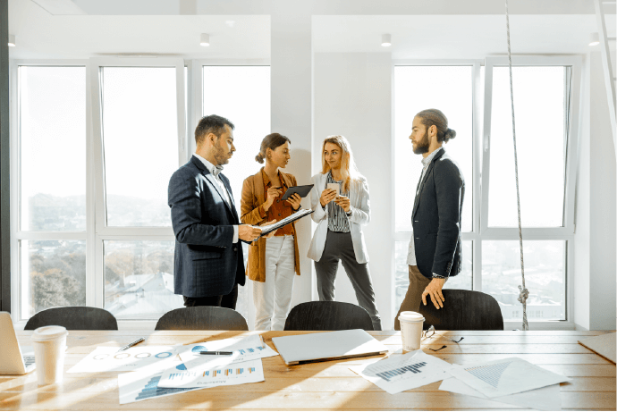 Business team standing in a conference room and talking.
