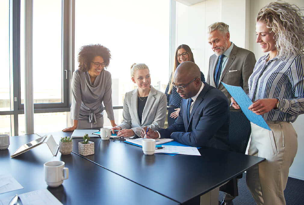 Business team collaborating around a table in a meeting room.