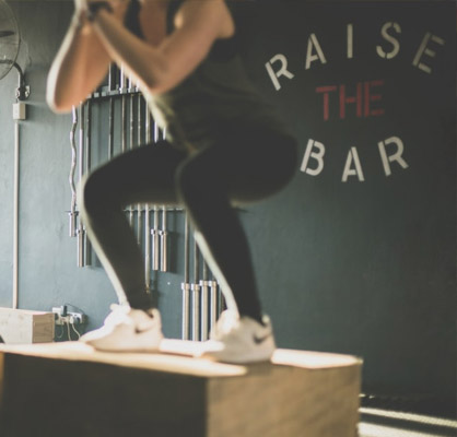 article image - girl doing box jumps