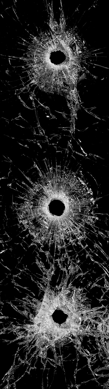 Pane of glass with a bullet hole in it.
