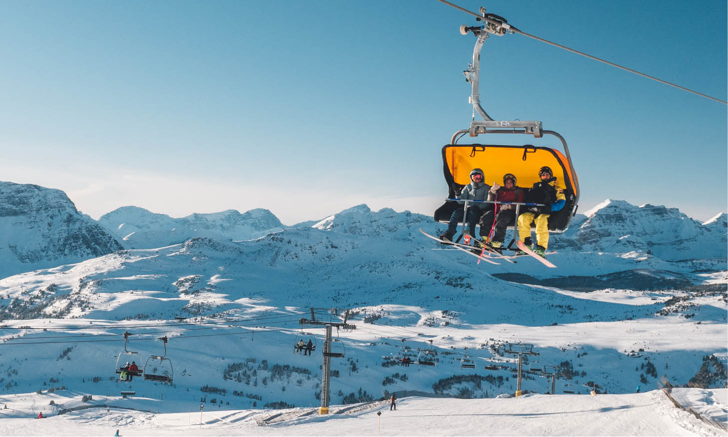 Skiers in a chairlift at Sunshine Village