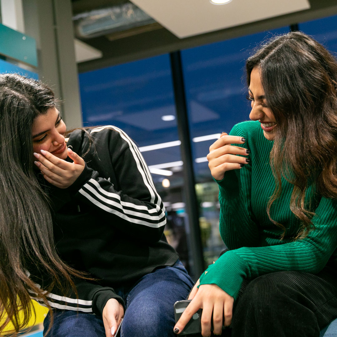 female students laughing at Northumbria University Pathway