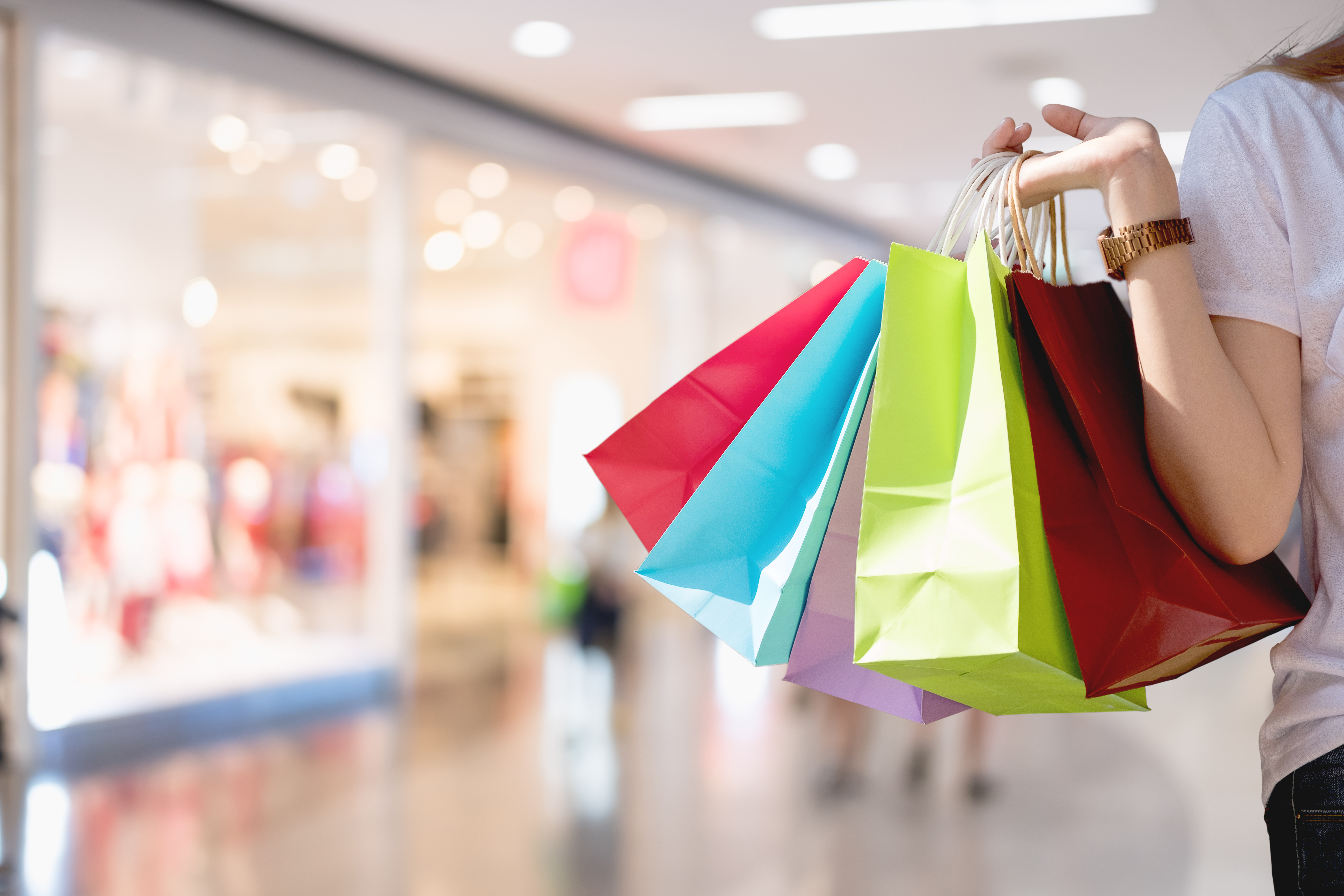 Closeup of woman holding shopping colorful of shopping bags at shopping mall with copy space - Shopping Concept
