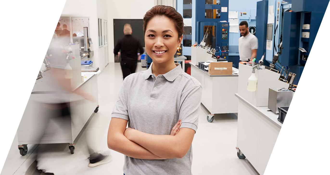 Close up photo of a female Asian engineer  smiling at the camera in a lab setting