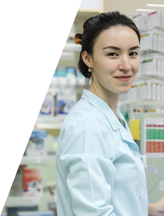 Photo of a female Pharmacist in the pharmacy smiling at the camera