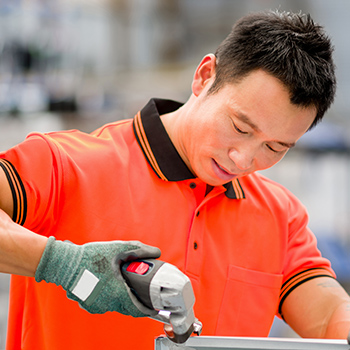 Close up image of an Asian male worker in a factory