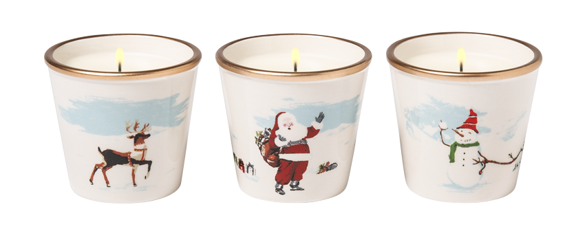 A set of candles featuring santa illustrations