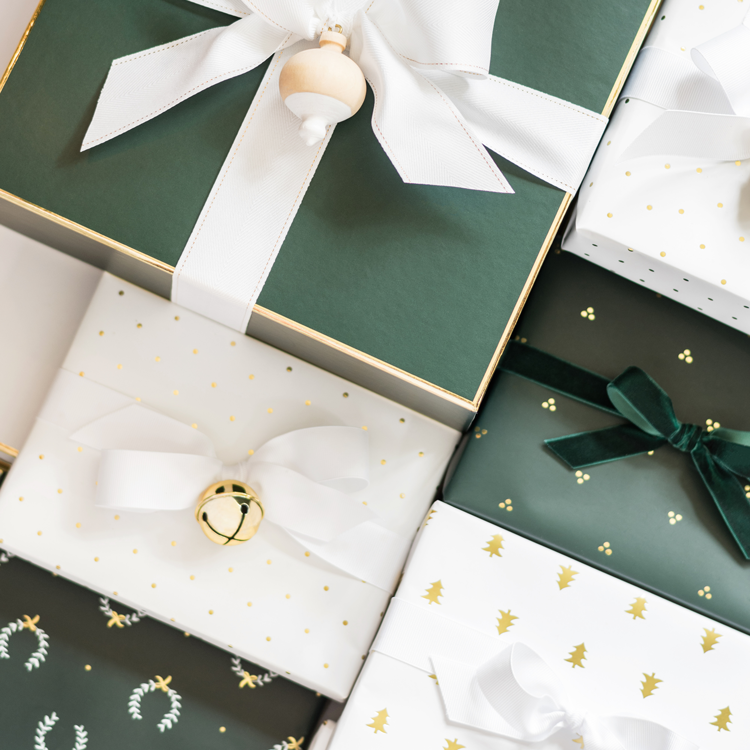 Gifts wrapped in green and white sugar paper wrapping
