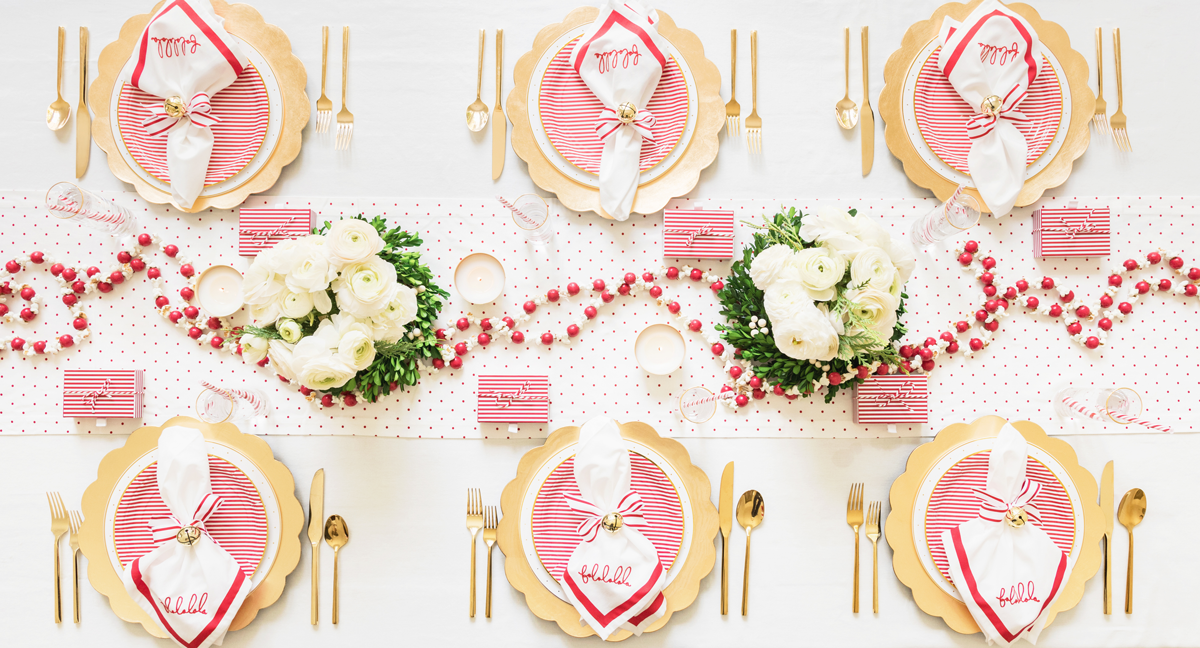 Red and Gold place setting on a dining table