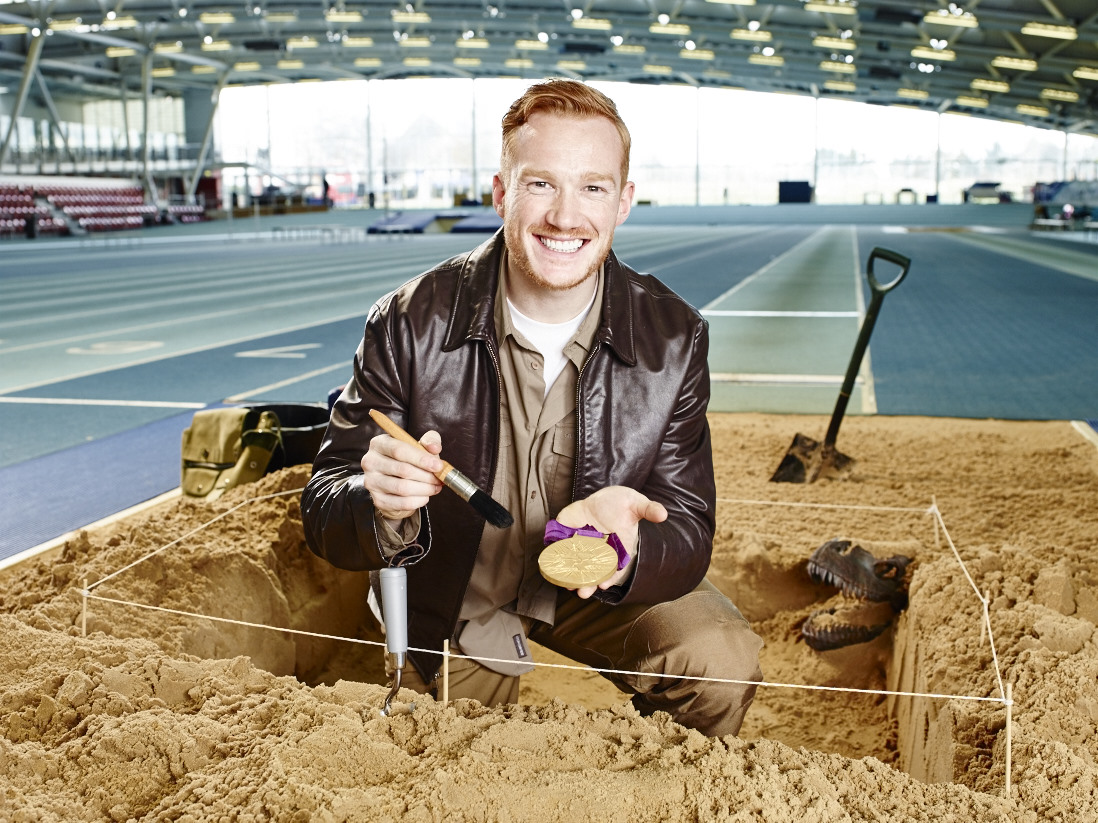 Rhapsody Photography, Disney Campaign, Man sitting in the sand with golden medal, Archeology