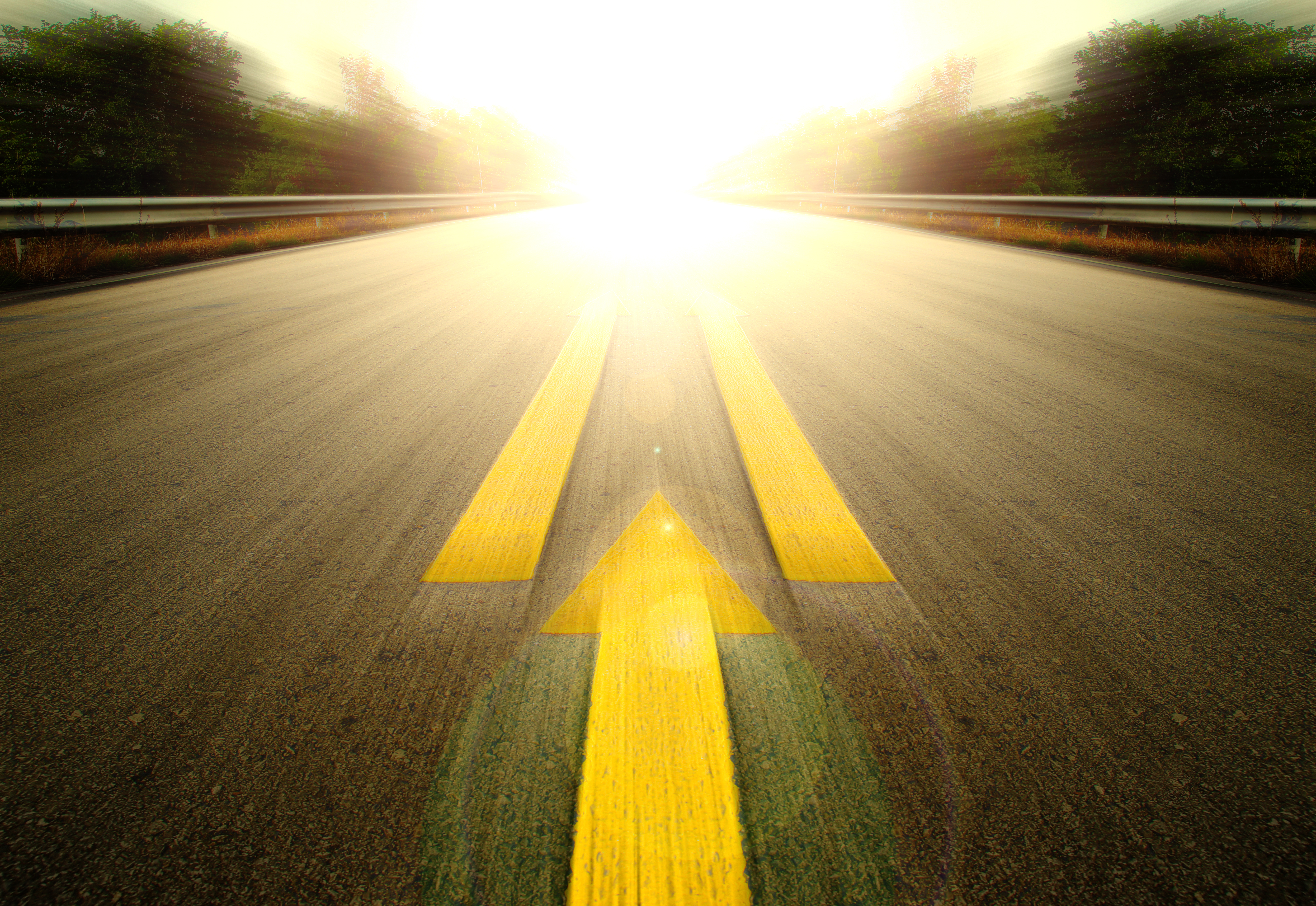 Road With Painted Yellow arrow Line.