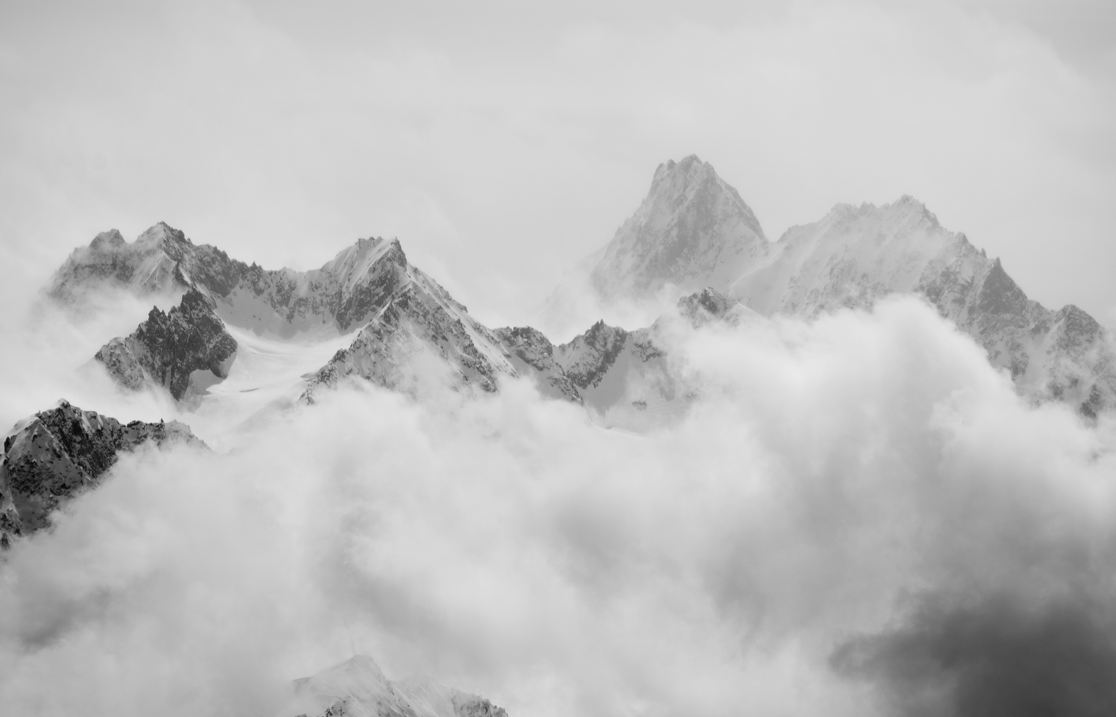 Atmospheric clouds linger around the peaks of the Swiss alps after a spring snow storm.