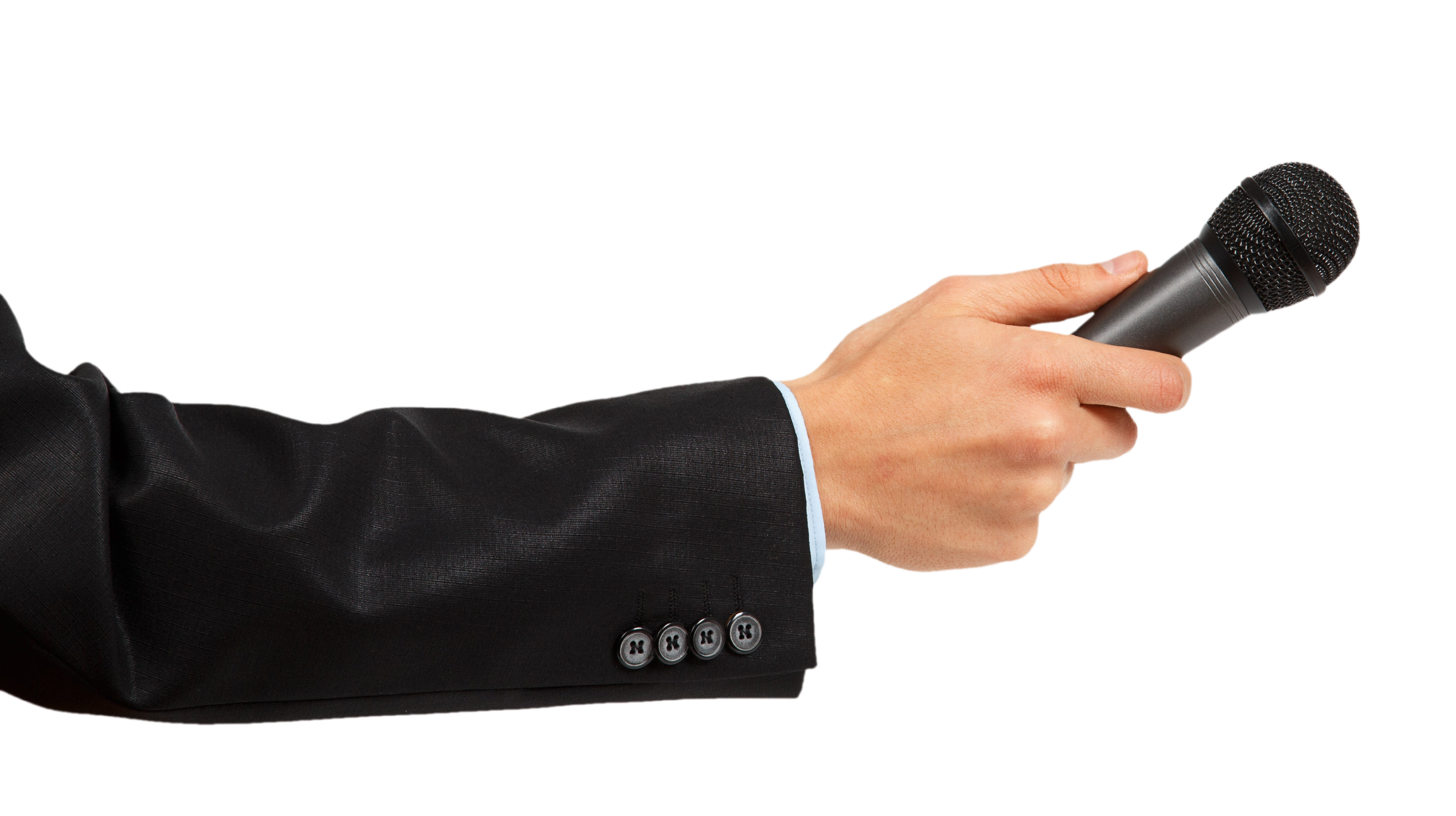 Man's hand in black suit holding a microphone isolated on white background