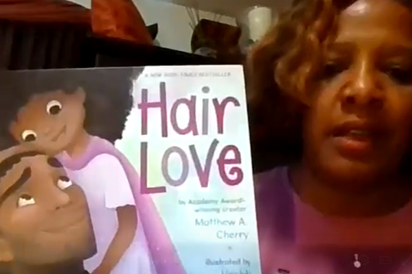 Crowe employee reading Hair Love by Matthew Cherry as part of our Story Time initiative with Boys and Girls Club of America.