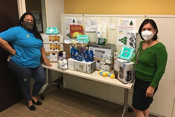 Crowe employees collecting food items to donate to those in need.