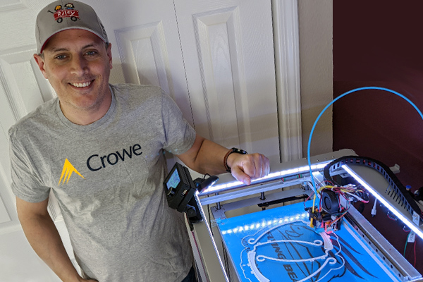 Crowe employee printing masks on his 3d printer.