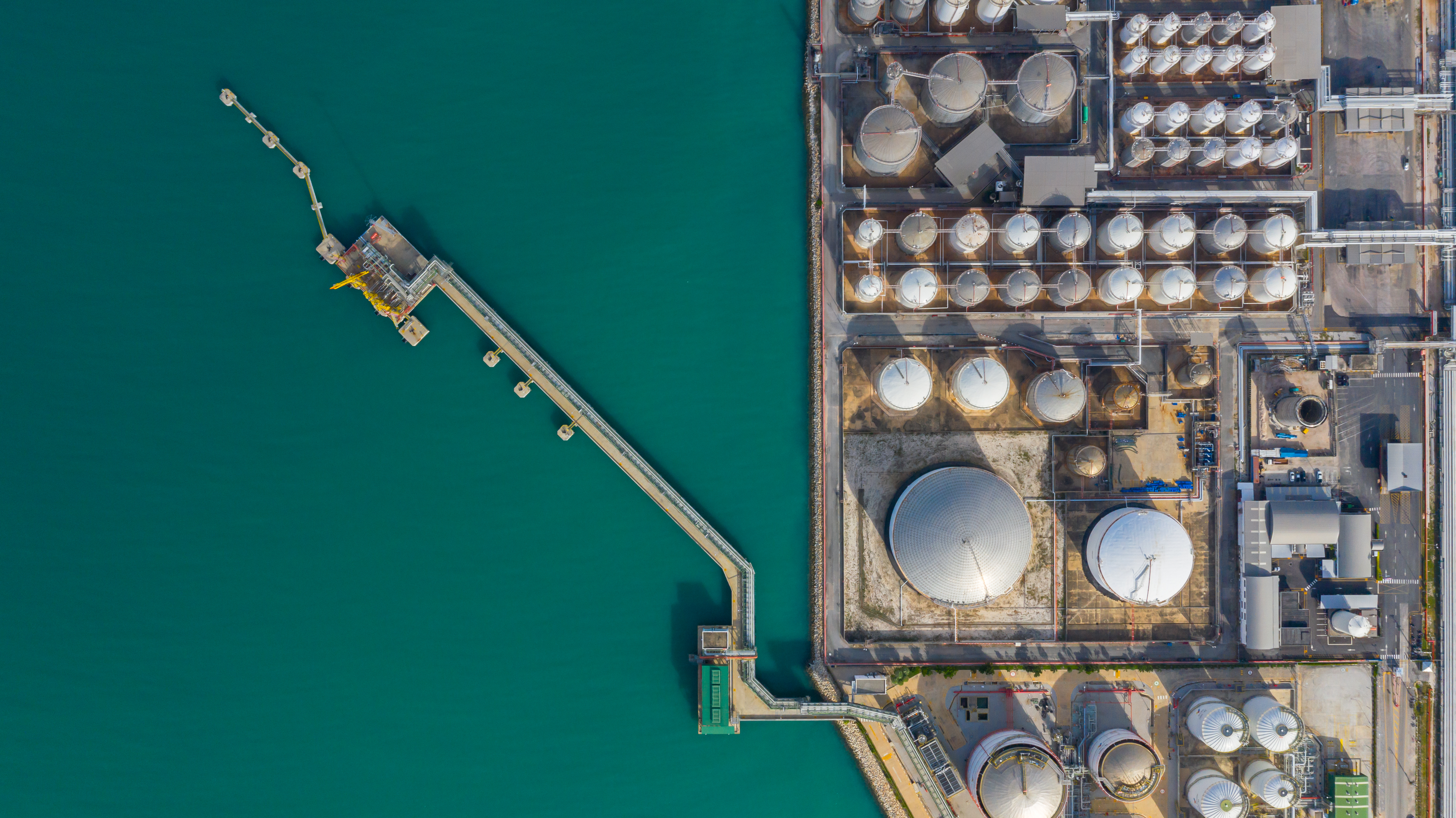 Aerial view of tank terminal with lots of oil storage tank and petrochemical storage tank in the harbour, Industrial tank storage aerial view.
