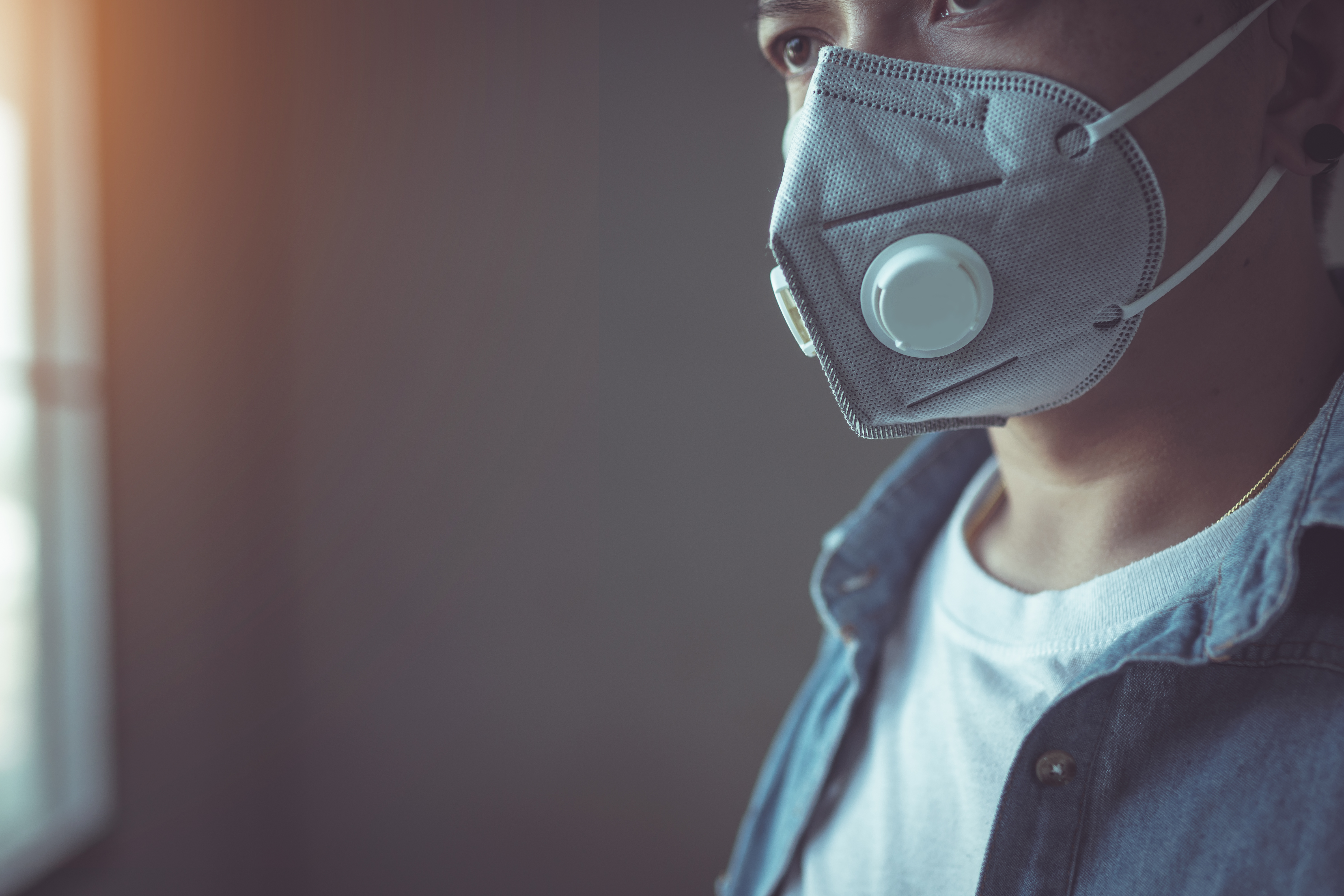 The man wearing a mask to protect against Coronavirus or Covid-19 virus And to prevent dust PM 2.5