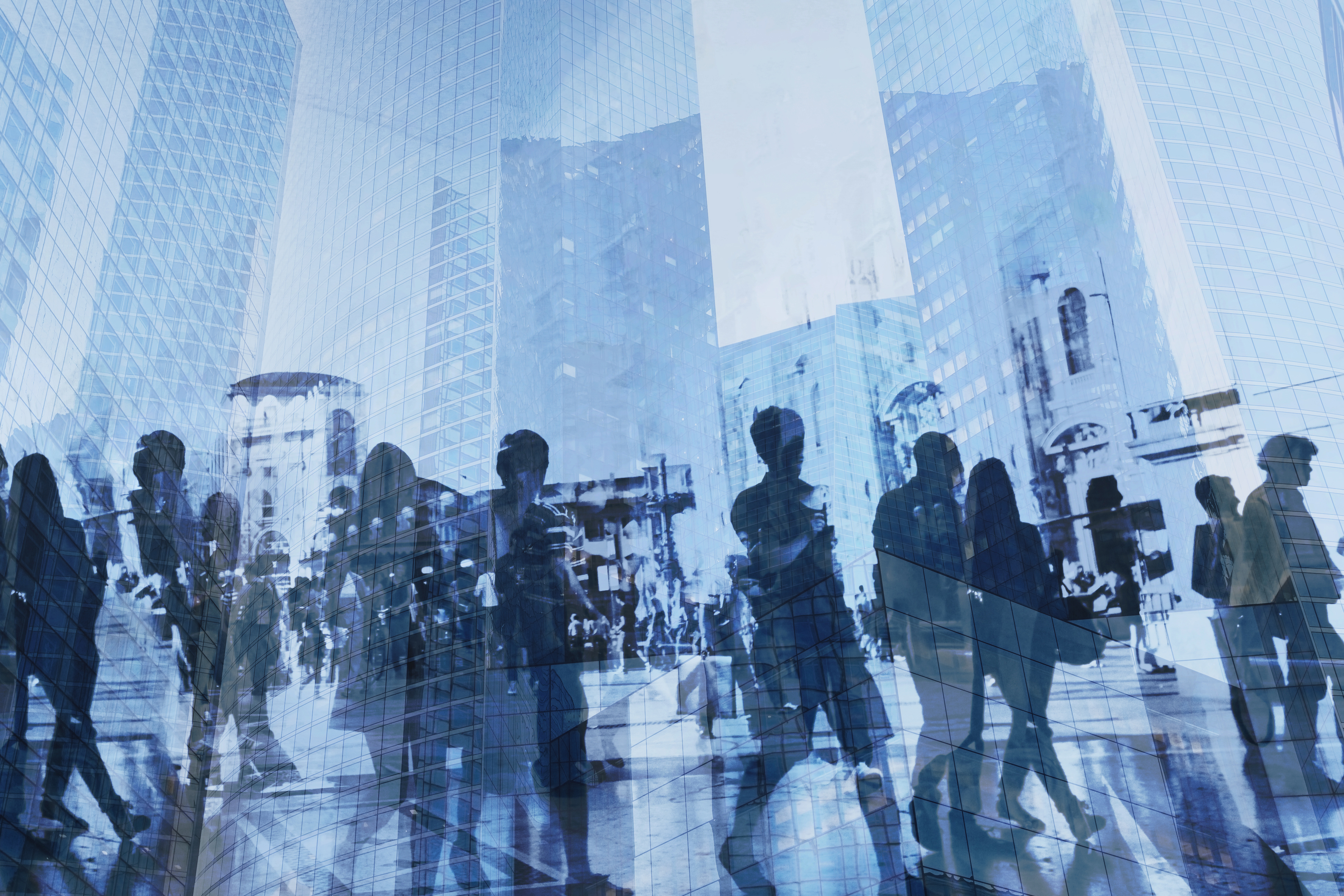 double exposure of business people walking on busy street of modern city, office buildings corporate background