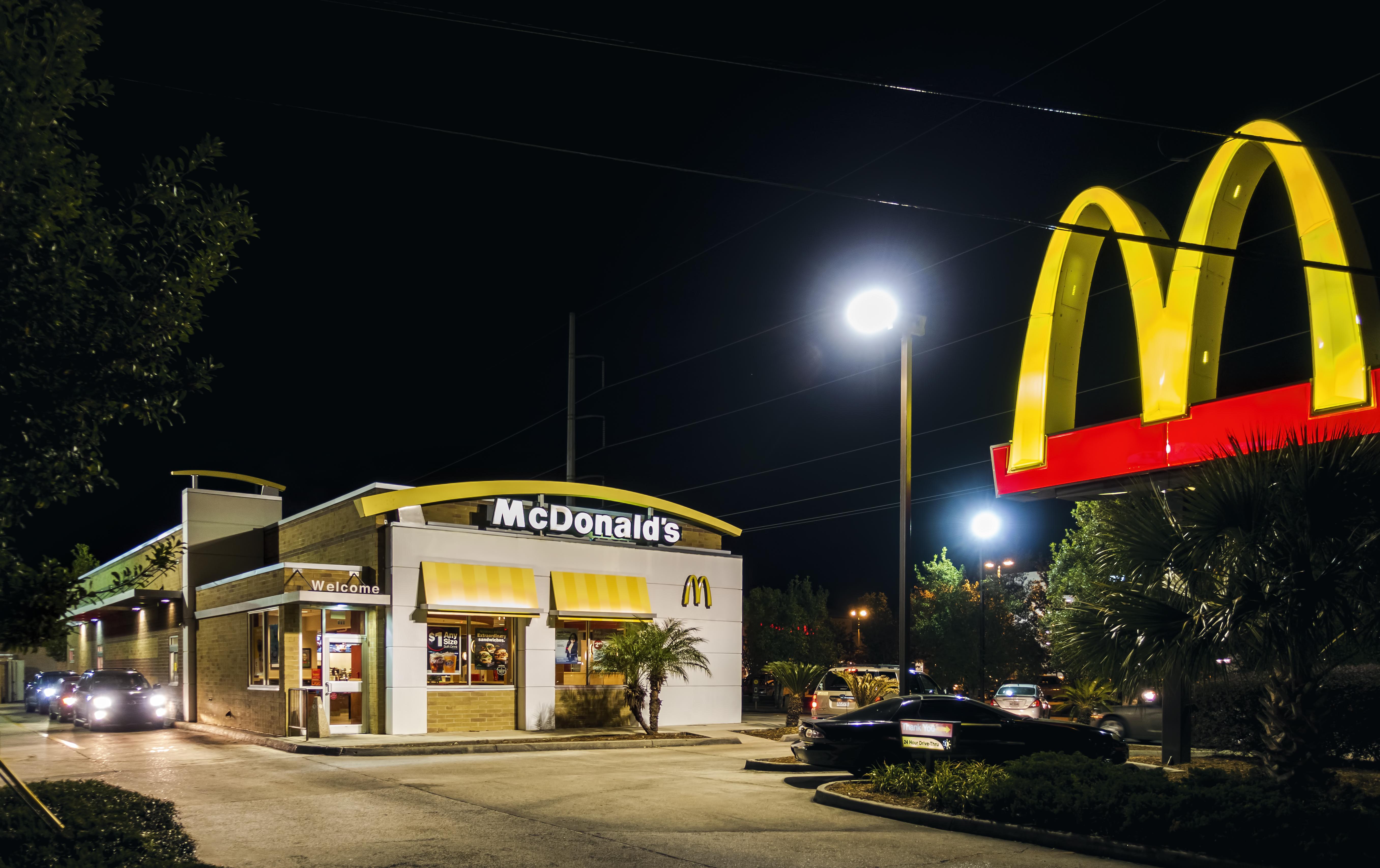 New Orleans, USA - Nov 29, 2017: McDonald's Family Restaurant drive-through and external car park. Night scene along Verterans Boulevard. McDonald's is now a global burger chain.