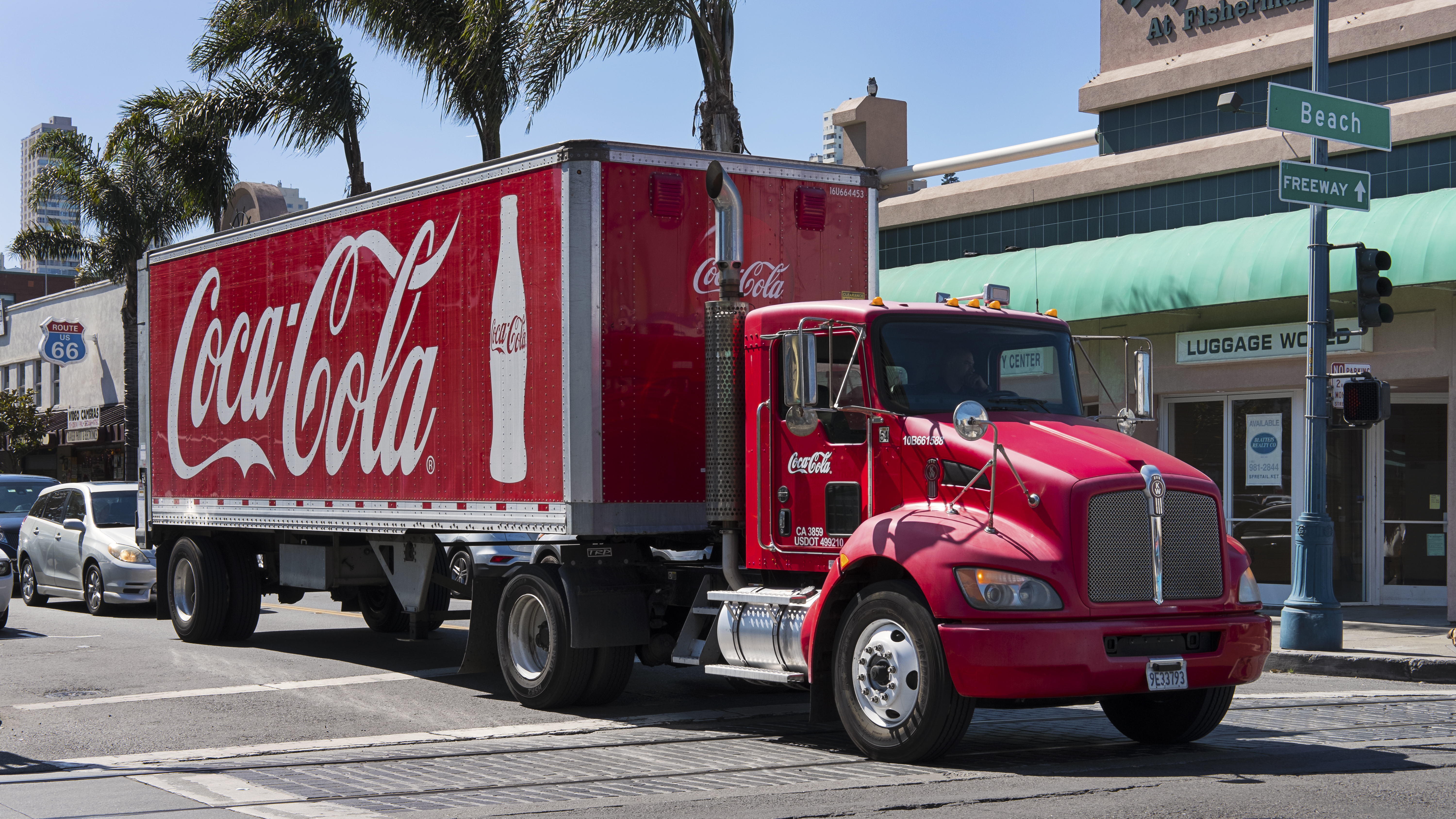 San Francisco, California, USA - September 22, 2017: famous red large Coca Cola truck stopped on a road that goes towards The Fisherman's Wharf