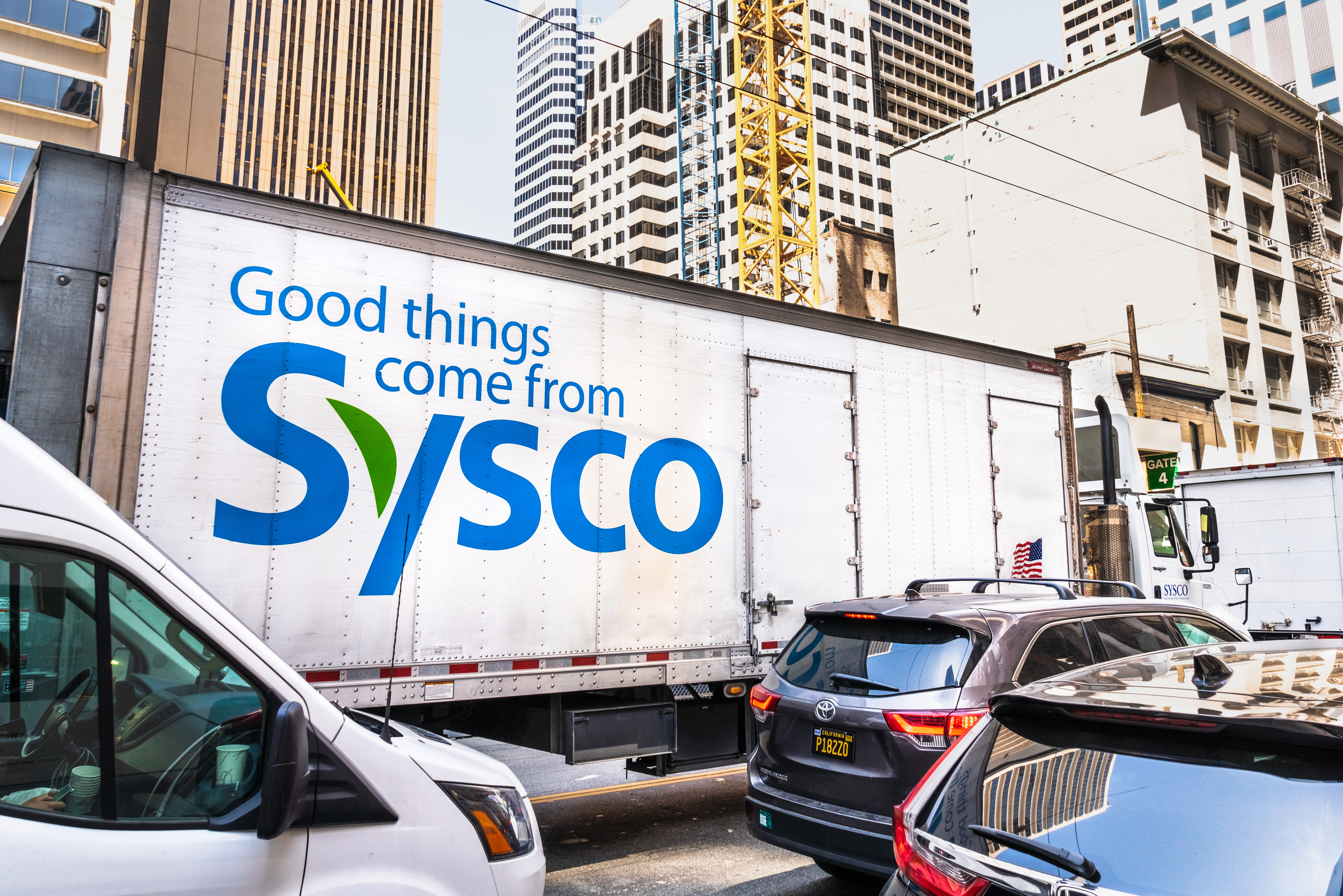 Aug 21, 2019 San Francisco / CA / USA - Sysco truck driving on a street; Sysco Corporation is an American multinational distributor of food and related products primarily to the food-service industry
