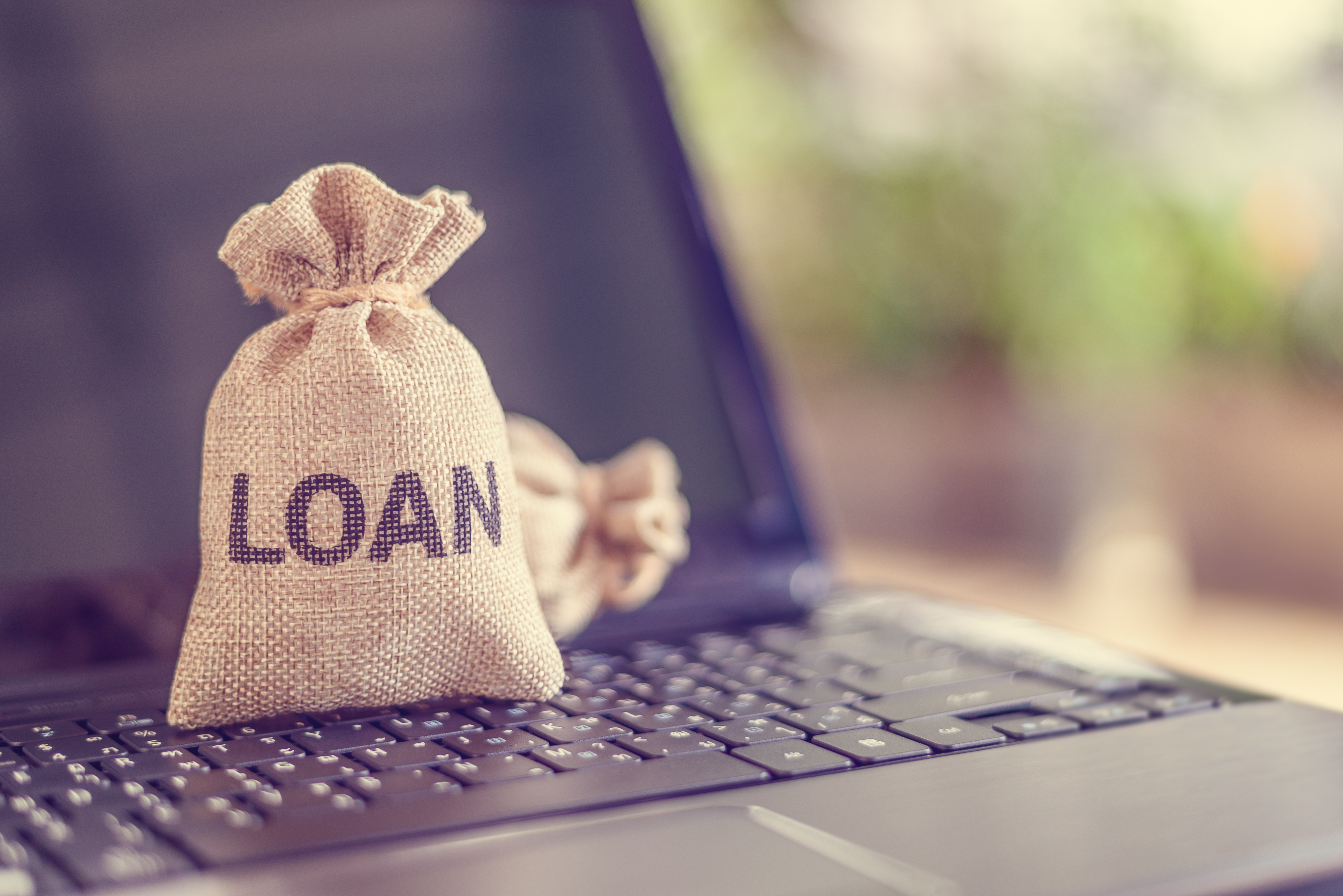 Depicting peer-to-peer lending, the practice of lending money to individual or business via online service among lenders and borrowers