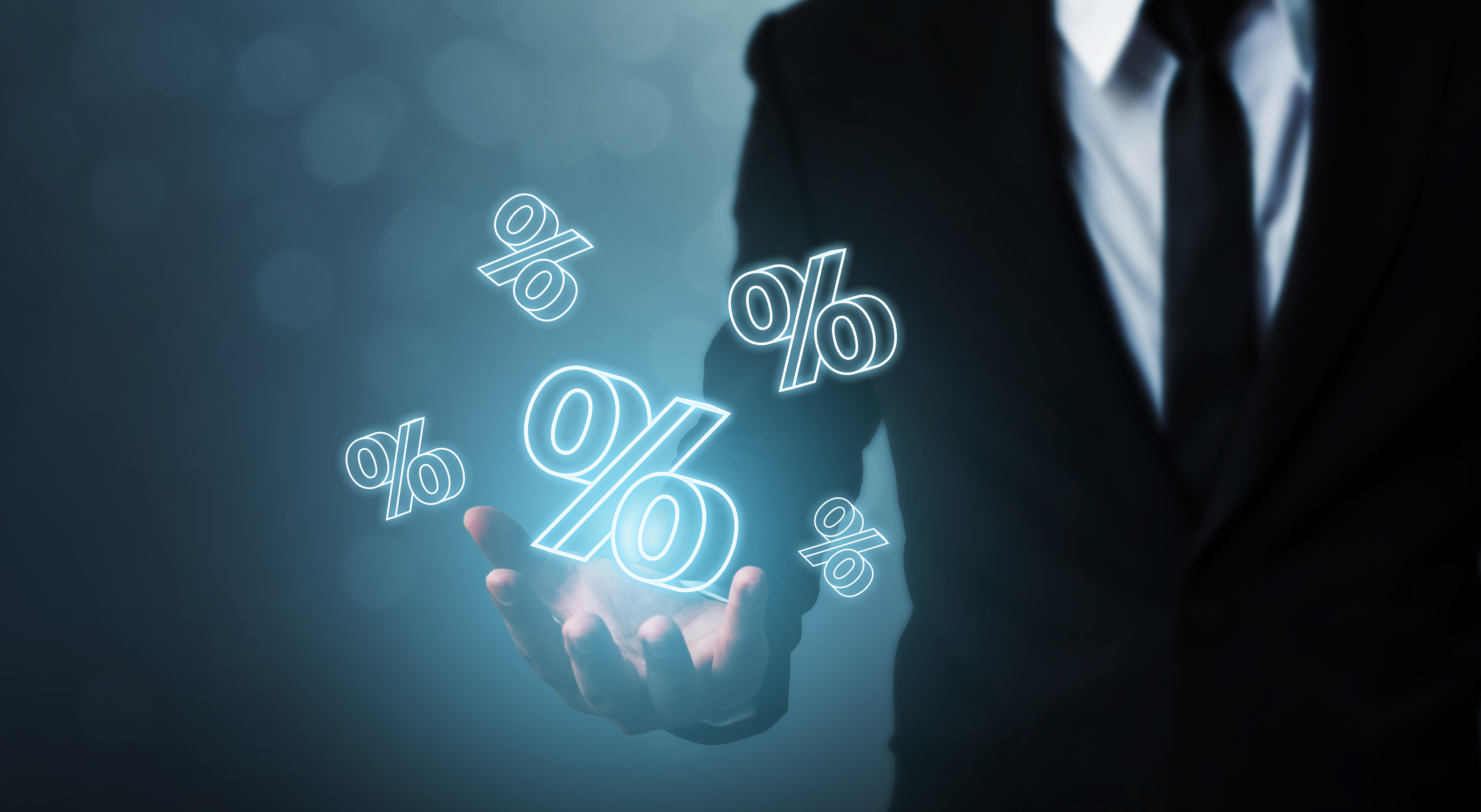 Interest rate financial and mortgage rates concept. Businessman hand show icon percent 3d sign