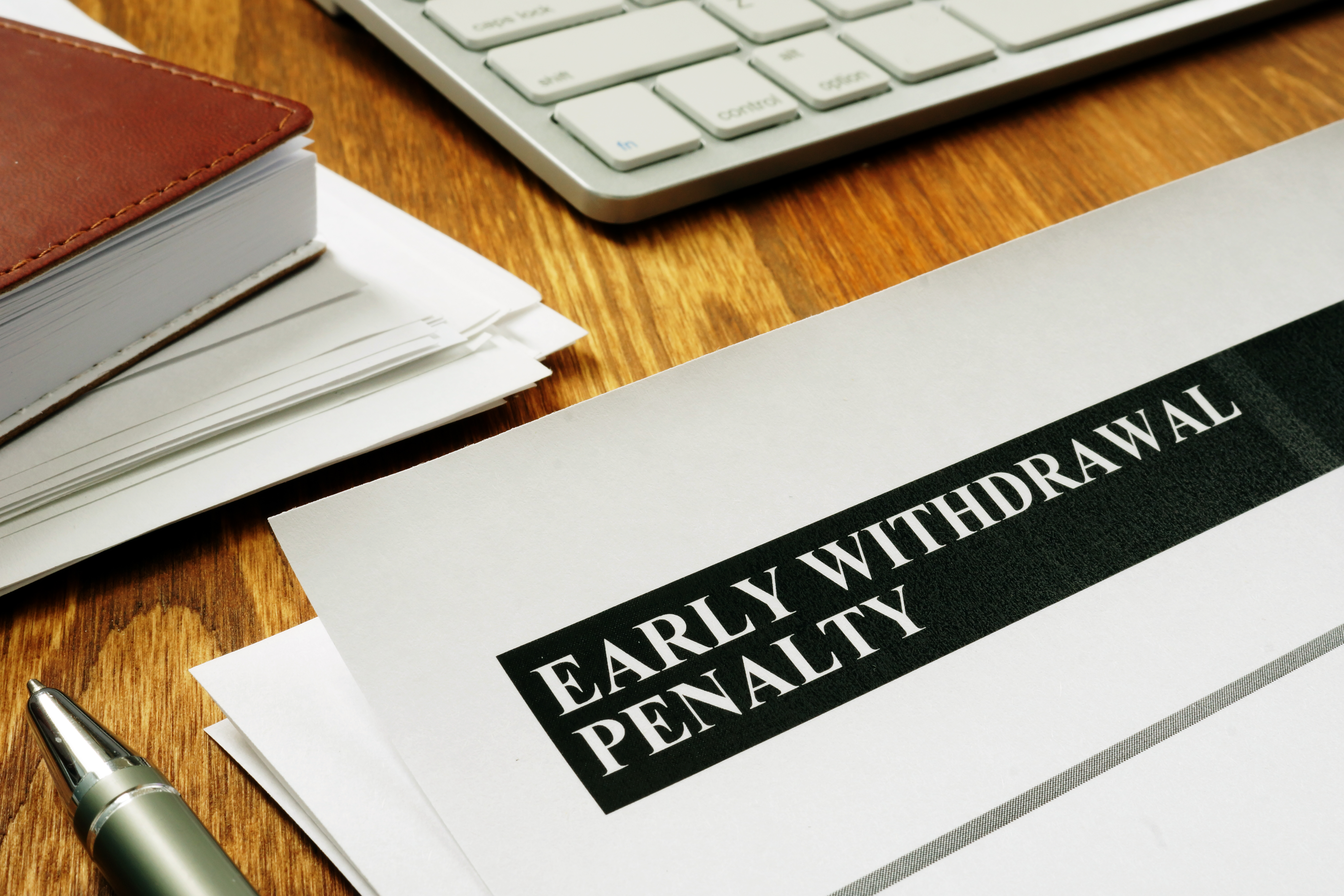 Early withdrawal penalty letter on the desk.