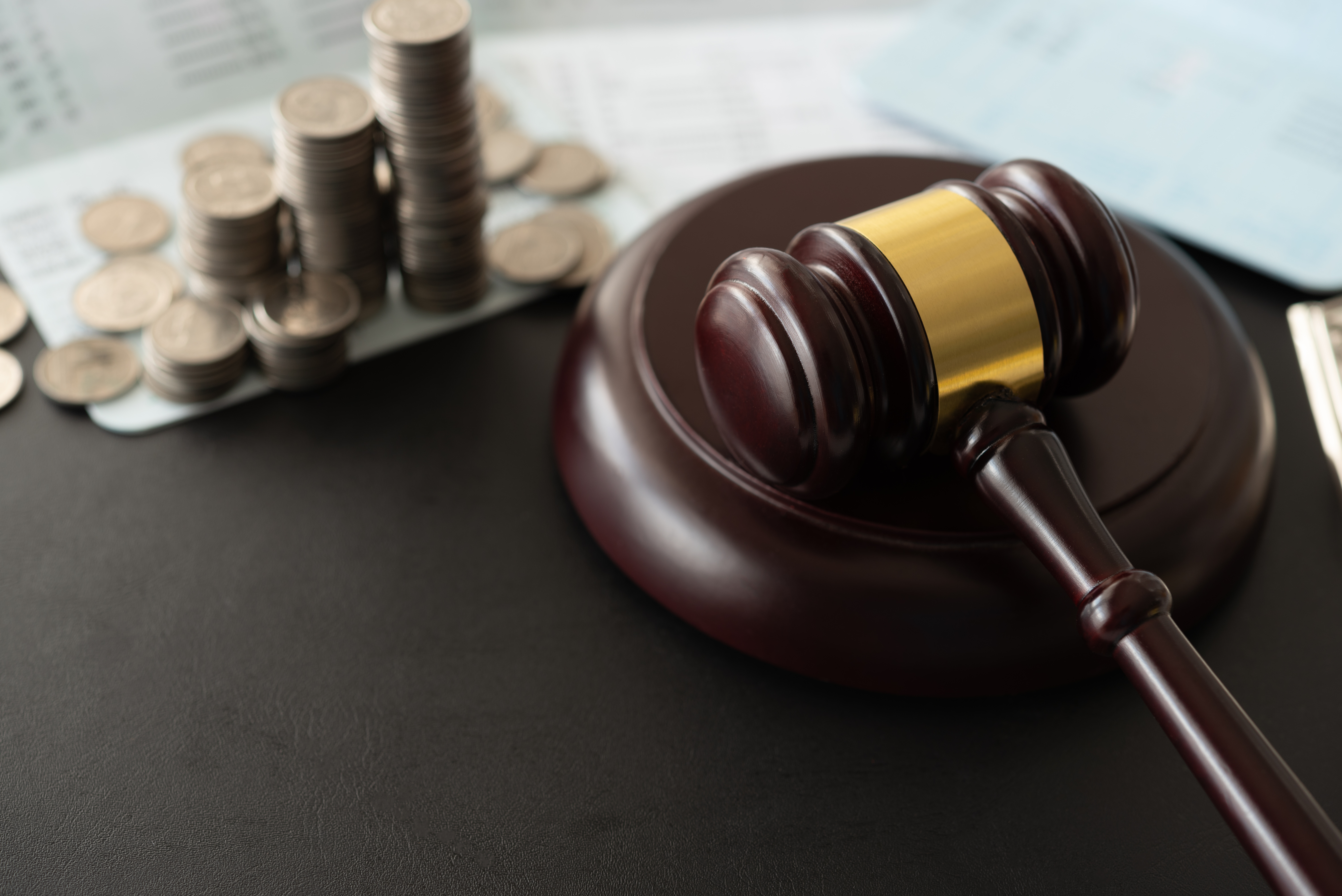 gavel judge with coin money and book bank accounts. banking money finance law.