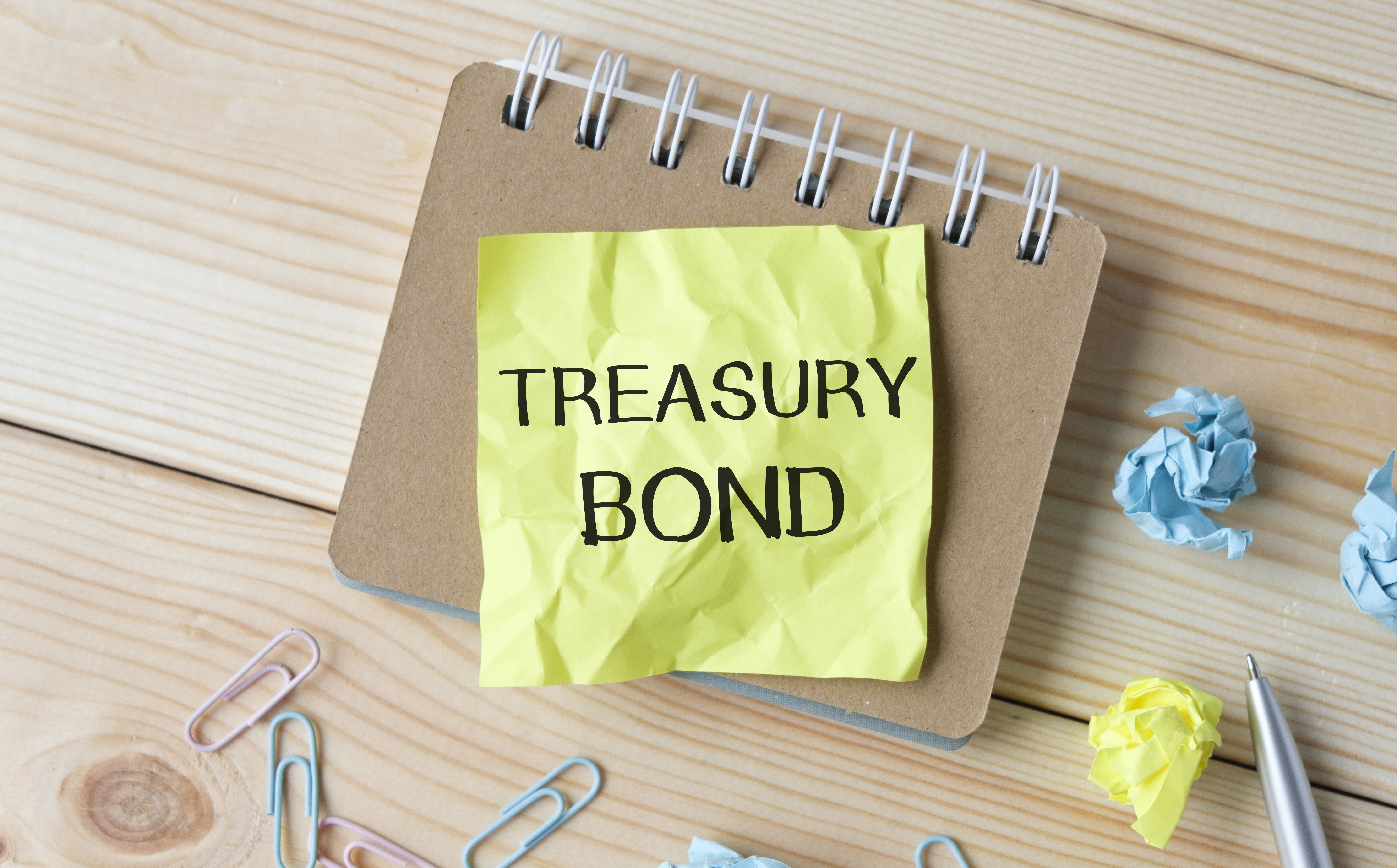 TREASURY BOND text on notepad. Business concept.